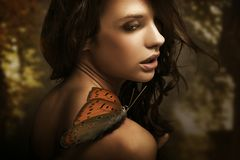 Beauty brunette. Young beauty brunette with butterfly royalty free stock photography