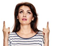 Beauty Brunette gesturing up Stock Photo