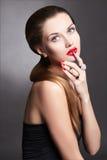 Beauty brunette girl in jewelry rings royalty free stock photo