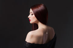 Beauty brunette Girl with a necklace Royalty Free Stock Photo