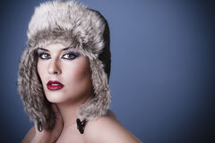 A beauty brunette girl with snow hat Royalty Free Stock Photo