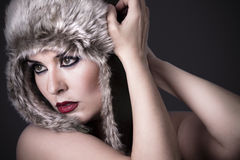 A beauty brunette girl with snow hat Stock Photo