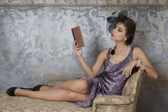 Beauty brunette model reading book Stock Image