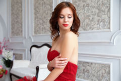 Beauty Brunette model woman in evening red dress. Beautiful fash Royalty Free Stock Images