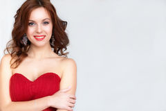 Beauty Brunette model woman in evening red dress. Beautiful fash Stock Images