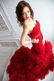 Beauty Brunette model woman in evening red dress. Beautiful fash Royalty Free Stock Photos