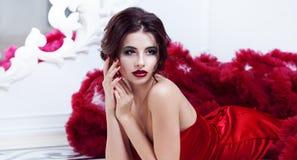 Beauty Brunette model woman in  evening red dress Stock Photos