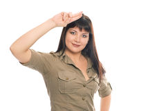 Beauty brunette soldier girl salute Royalty Free Stock Images