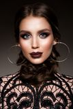 Beauty Brunette Woman with Perfect Makeup. Beautiful Professional Holiday Make-up. stock photo