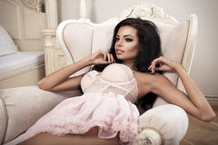 Beauty brunette woman in stylish room Stock Image