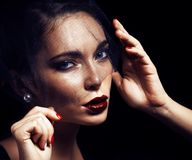 Beauty brunette woman under black veil with red manicure close u Stock Image