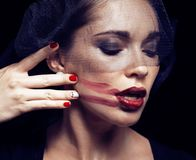 Beauty brunette woman under black veil with red manicure close u. P, grieving widow, halloween makeup luxury concept Royalty Free Stock Photography