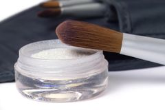 Beauty brushes. Travel set of beauty brushes and glittering powder Royalty Free Stock Image