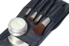 Beauty brushes. Travel set of beauty brushes and glittering powder Royalty Free Stock Images