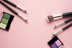 Beauty brushes. Creative concept beauty fashion photo of cosmetic product make up brushes kit on pink background stock image