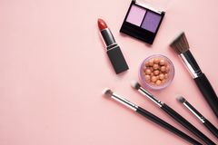 Beauty brushes. Creative concept beauty fashion photo of cosmetic product make up brushes kit on pink background stock photography