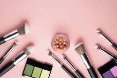 Beauty brushes. Creative concept beauty fashion photo of cosmetic product make up brushes kit on pink background royalty free stock photos
