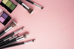 Beauty brushes. Creative concept beauty fashion photo of cosmetic product make up brushes kit on pink background royalty free stock photography
