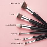 Beauty brushes. Creative concept beauty fashion photo of cosmetic product make up brushes kit on pink background stock photo