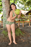 Beauty with Buko fruit. Beautiful Asian lady with Buko fruit on the beach stock photo