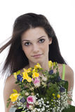 Beauty with a bunch of flowers Royalty Free Stock Images