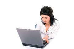 Beauty business brunette girl with laptop. On white background Royalty Free Stock Photo