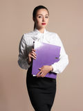 Beauty business woman. Beautiful girl in formal wear.accountant with a folder Royalty Free Stock Photo