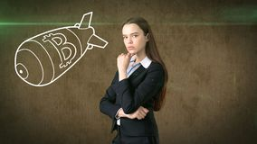 Beauty business woman standing near btc logo. Succesful Bitcoin investment. Concept of virtual criptocurrency. stock photos