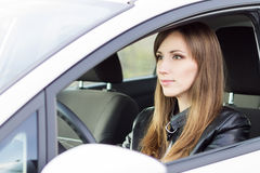 Beauty business woman in white car Stock Image