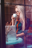 Beauty businesswoman drinking coffee and using laptop computer i Stock Photo
