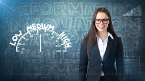 Beauty businesswoman on painted background with marketing words. Advertising, investment and business plan concept. Beauty businesswoman in suit on painted royalty free stock photography