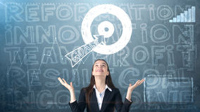 Beauty businesswoman on painted background with marketing words. Advertising, investment and business plan concept. Beauty businesswoman in suit on painted stock image