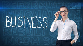 Beauty businesswoman on painted background with marketing words. Advertising, investment and business plan concept. Beauty businesswoman in suit on painted royalty free stock images