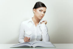 Beauty businesswoman reading book and noting. Office portrait on bright Royalty Free Stock Images