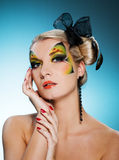 Beauty with butterfly face-art Royalty Free Stock Photography