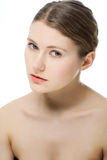 Beauty Care. Young beautiful woman against white Royalty Free Stock Image