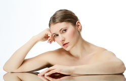 Beauty Care. Young beautiful woman is reflected even Royalty Free Stock Images