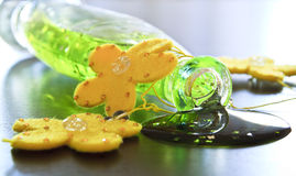 Beauty care. Bath gel bottle with yellow flowers on a table royalty free stock photo