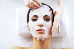 Beauty and Care. Beautiful Young Girl with Mask in Spa Salon. Spa Therapy. High Resolution.  stock photos