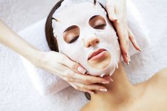 Beauty and Care. Beautiful Young Girl with Mask in Spa Salon. Spa Therapy. High Resolution.  stock photography