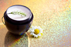 Beauty care product & flower on shining background Royalty Free Stock Image