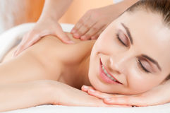 Beauty and care at spa. Beautiful young woman receiving hand massage on her back at beauty spa salon Stock Photo