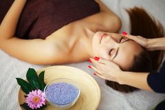 Beauty and Care. Spa Salon. Girl With Towel on the Head. The Woman With Pure Skin Lays On The Massage Tables And Relaxes. Skin Ca. Re. High Resolution stock image