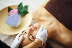 Beauty and Care. Spa Salon. Girl With Towel on the Head. The Woman With Pure Skin Lays On The Massage Tables And Relaxes. Skin Ca. Re. High Resolution royalty free stock image