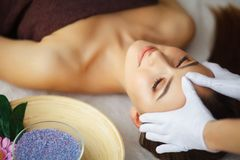 Beauty and Care. Spa Salon. Girl With Towel on the Head. The Woman With Pure Skin Lays On The Massage Tables And Relaxes. Skin Ca. Re. High Resolution stock photo