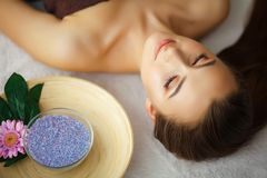 Beauty and Care. Spa Salon. Girl With Towel on the Head. The Woman With Pure Skin Lays On The Massage Tables And Relaxes. Skin Ca. Re. High Resolution royalty free stock photography