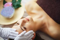 Beauty and Care. Spa Salon. Girl With Towel on the Head. The Woman With Pure Skin Lays On The Massage Tables And Relaxes. Skin Ca. Re. High Resolution stock images