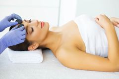 Beauty and Care. Young Girl with Clean Skin in Spa Salon. Woman Relaxing And Lying With Closed Eyes. High Resolution royalty free stock photos