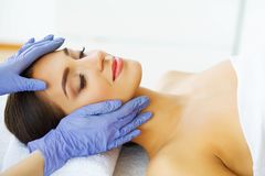 Beauty and Care. Young Girl with Clean Skin in Spa Salon. Woman Relaxing And Lying With Closed Eyes. High Resolution stock images