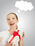 Beauty  cheerful girl with a Christmas gift Royalty Free Stock Photos